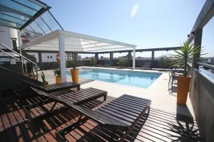 The swimming pool at or near Hotel Bicentenario Suites & Spa