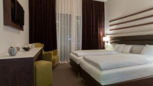 Ein Bett oder Betten in einem Zimmer der Unterkunft Hotel Nordhausen