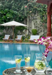 The swimming pool at or near The Grand Imperial - Heritage Hotel