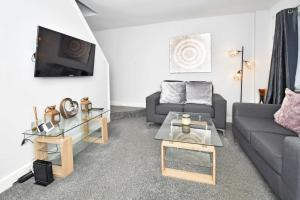 A seating area at We're open! Mayer House, City Centre Location!