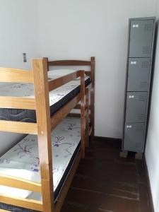 A bunk bed or bunk beds in a room at Salvador Surf Hostel
