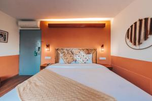 A bed or beds in a room at Selina Posada Miraflores