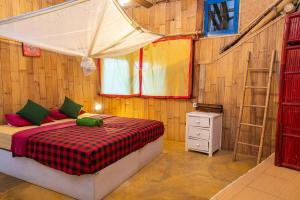 A bed or beds in a room at Serenity Eco Guesthouse