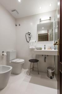 Een badkamer bij Hotel Carlton