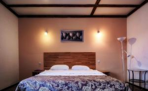 Кровать или кровати в номере Знаменитый Дом на Щорса