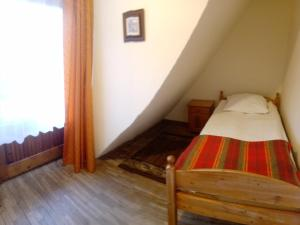A bed or beds in a room at Hostel Stara Polana