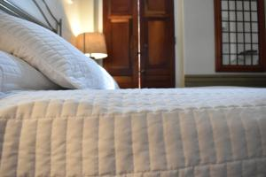 A bed or beds in a room at Boutique Hotel Belgica