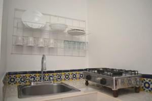 A kitchen or kitchenette at Las Mariposas Eco-Hotel & Studios