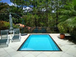 The swimming pool at or close to Chalé Meu Agresthe