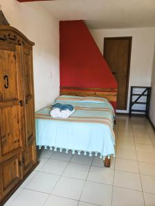 Кровать или кровати в номере La Abuelita Hostal