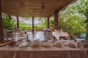 Um restaurante ou outro lugar para comer em Pousada Alto do Cajueiro