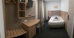 Ein Bett oder Betten in einem Zimmer der Unterkunft Hotel-Restaurant Kriemhilde