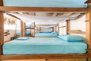 A bed or beds in a room at El Rio Hostel