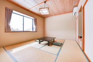 A bed or beds in a room at Kanoe