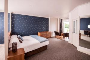 A bed or beds in a room at The Woolacombe Bay Hotel