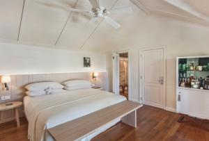 A bed or beds in a room at LUX* Le Morne Resort