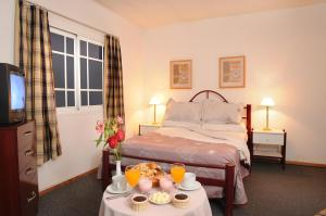 Una cama o camas en una habitación de Hotel Salerno