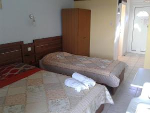 Ένα ή περισσότερα κρεβάτια σε δωμάτιο στο Drenos Rooms