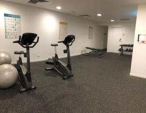 The fitness center and/or fitness facilities at High-End stylish Apartment by Serain Residences