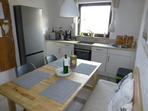 Küche/Küchenzeile in der Unterkunft Hornbacher Vogelhaus