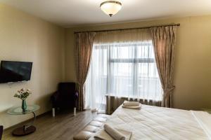 Кровать или кровати в номере Отель «Медный Двор»