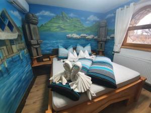 Postel nebo postele na pokoji v ubytování Resort Svět
