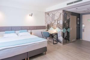 Łóżko lub łóżka w pokoju w obiekcie Scandic Gdańsk