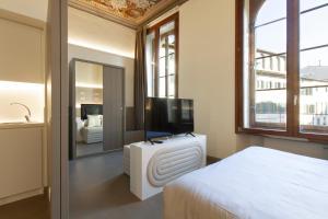 Letto o letti in una camera di Palazzo dei Ciompi Suites