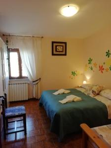 A bed or beds in a room at B&B Villa Claudia