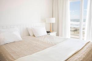 Una cama o camas en una habitación de Terrazas Al Mar