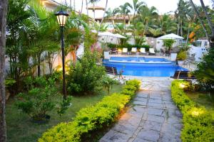 A view of the pool at Auberge de la Langouste or nearby