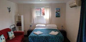 A bed or beds in a room at Lake Tekapo Cottages