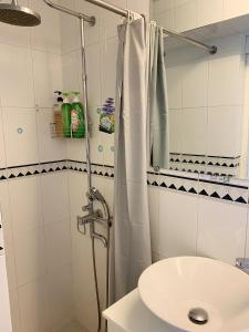 Ein Badezimmer in der Unterkunft Concerto Inn