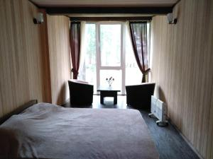Кровать или кровати в номере Turgoyak