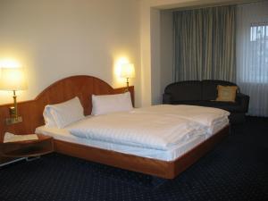 Ein Bett oder Betten in einem Zimmer der Unterkunft Hotel-Restaurant-Kolb