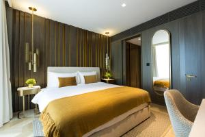 A bed or beds in a room at Eden Dubai - FIVE Residences