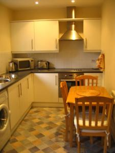 A kitchen or kitchenette at Orchard Properties