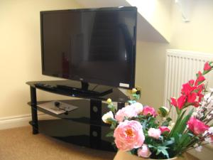 A television and/or entertainment center at Orchard Properties