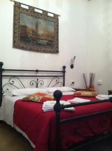 A bed or beds in a room at B&B Ca' Dor