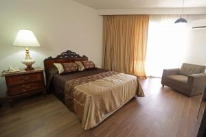 A bed or beds in a room at Hotel Imperial Saltillo