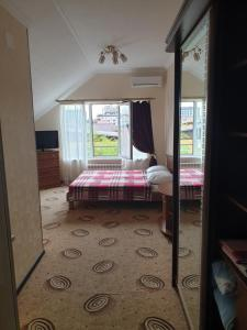 Кровать или кровати в номере Bumerang Hotel