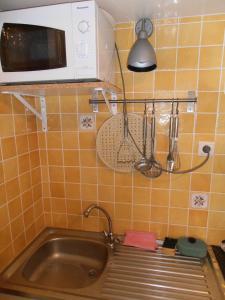 Küche/Küchenzeile in der Unterkunft Bruges Blankenberge Coast Condo