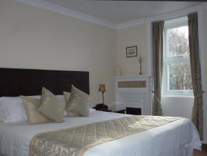 A bed or beds in a room at Arisaig Hotel