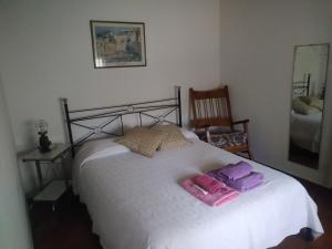 A bed or beds in a room at DEPARTAMENTO EN LOMA HERMOSA 2