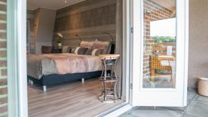 Een bed of bedden in een kamer bij B&B Hertenhoef, Fluitenberg (Hoogeveen)