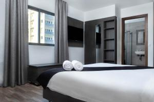 A bed or beds in a room at Hotel Kapital
