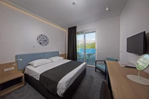 A bed or beds in a room at Hotel Osmine - All Inclusive