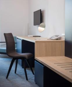 Een TV en/of entertainmentcenter bij Hotel Osmine - All Inclusive