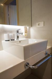 Een badkamer bij Hotel Osmine - All Inclusive