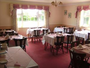 A restaurant or other place to eat at Westfield House